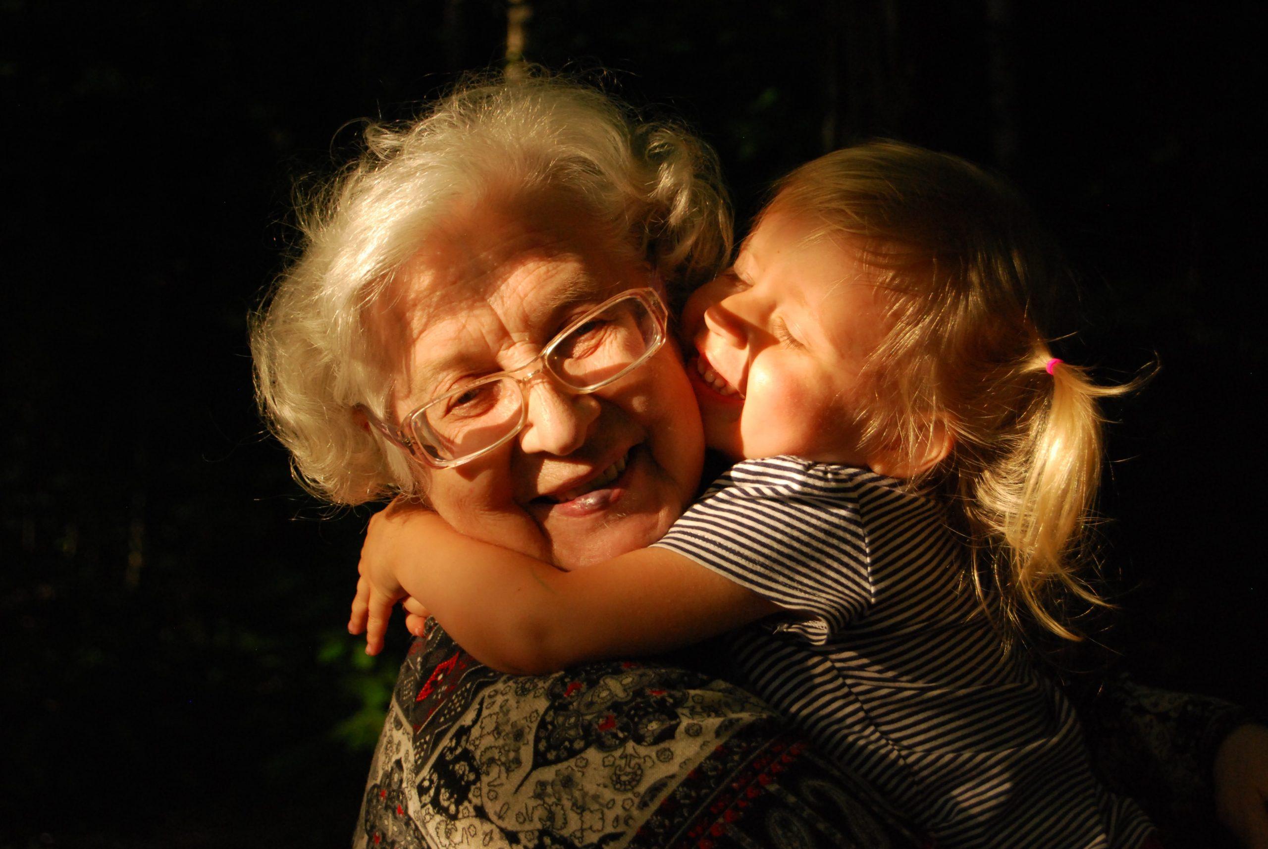 older woman holding grandchild