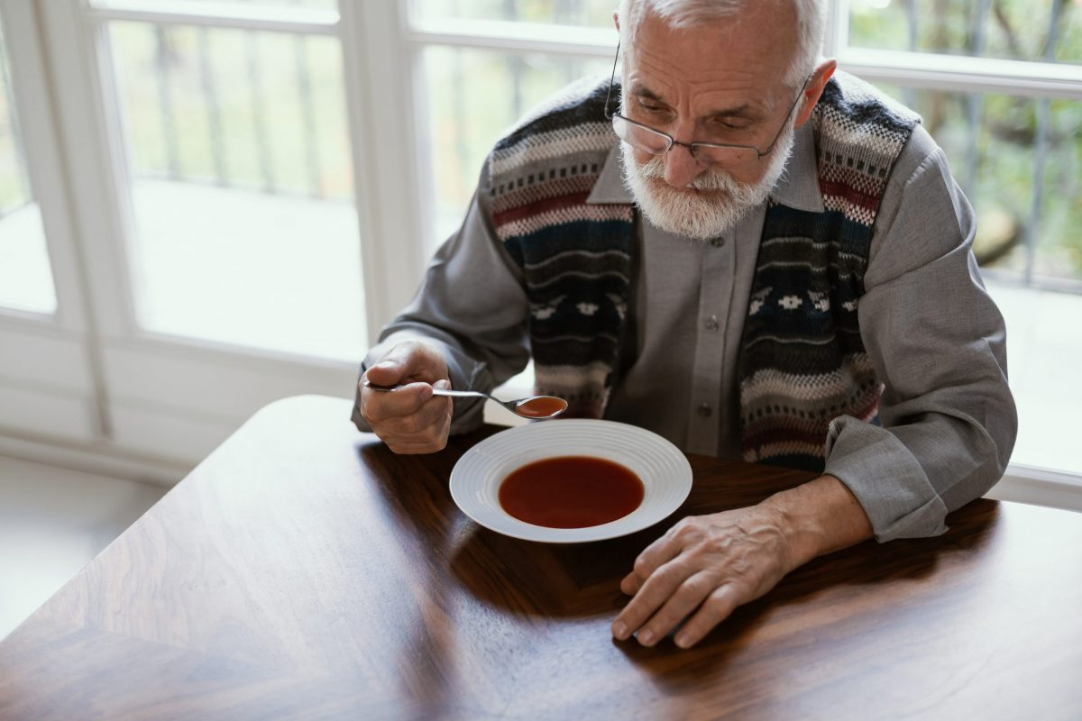Older,Sad,Man,Eating,Dinner,Alone,In,The,Apartment