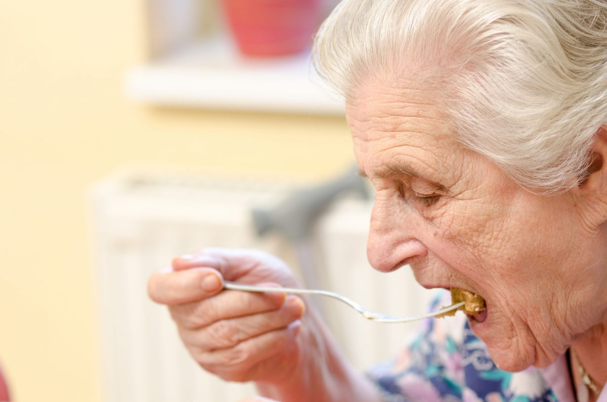 Old,Woman,Eating,Soup