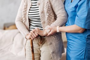 nurse helping older patient