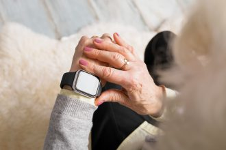 OLDER PERSON WEARING SMART WATCH