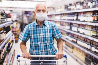older man shopping in supermarket